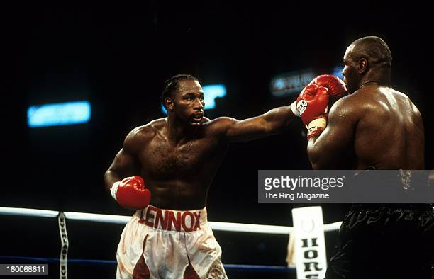 Lennox Lewis throws a punch to Mike Tyson during the fight at The Pyramid in Memphis Tennessee Lennox Lewis won the WBC heavyweight title IBF...