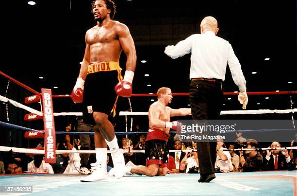 Lennox Lewis walks to his corner after knocking down Tommy Morrison during the fight at the Convention Centeron October 71995 in Atlantic City New...