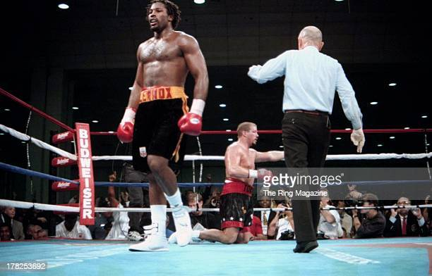 Lennox Lewis walks to his corner after knocking down Tommy Morrison during the fight at the Convention Center Atlantic City New Jersey Lennox Lewis...