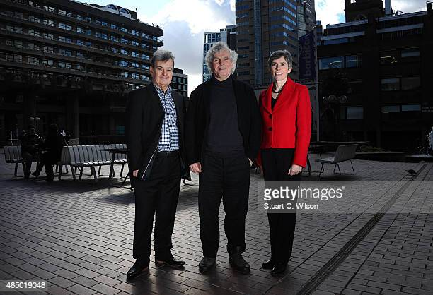 Lennox Mackenzie chairman of the LSO and Kathryn McDowell Managing Director of the LSO pose with Sir Simon Rattle after the announcement that Sir...