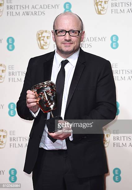 Lenny Abrahamson accepting the Best Actress award on behalf of Brie Larson for 'Room' poses in the winners room at the EE British Academy Film Awards...