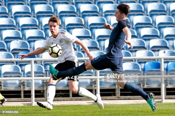 Lenny Borges of Germany U17 chalenges Luis Binks of England U17 during U17-Juniors Algarve Cup match between U17 Germany and U17 England at Algarve...