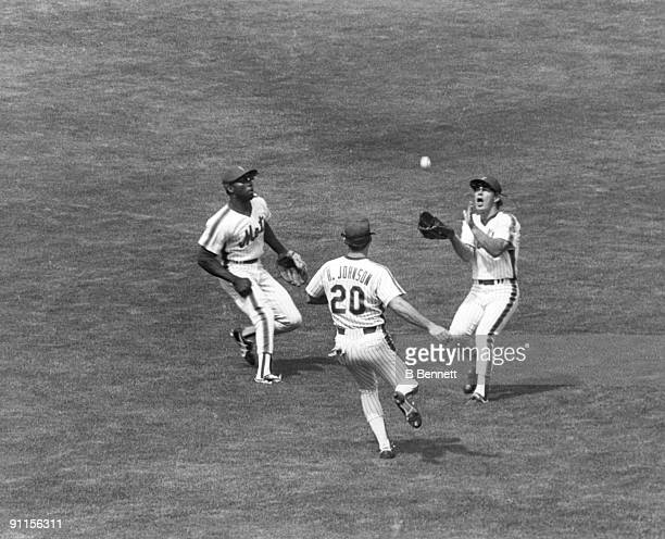Lenny Dykstra of the New York Mets catches a fly ball as teammates Mookie Wilson and Howard Johnson converge during a circa 198589 game at Shea...