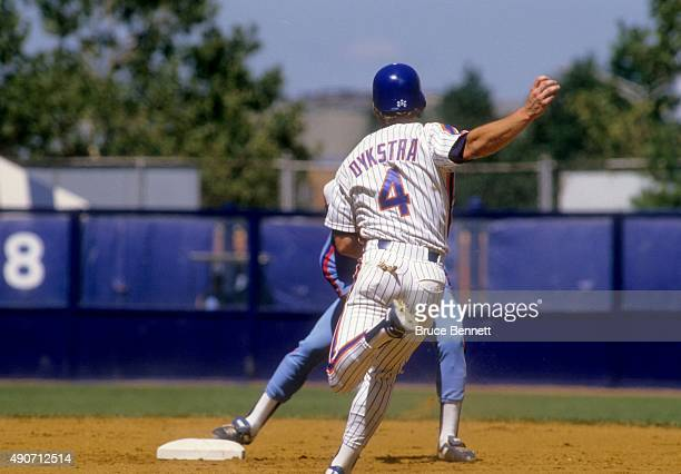 Lenny Dykstra of the New York Mets gets ready to slide into second base during an MLB game against the Montreal Expos in August 1987 at Shea Stadium...