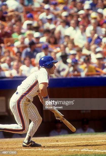 Lenny Dykstra of the New York Mets goes to bunt during an MLB game against the San Francisco Giants in August 1987 at Shea Stadium in Flushing New...