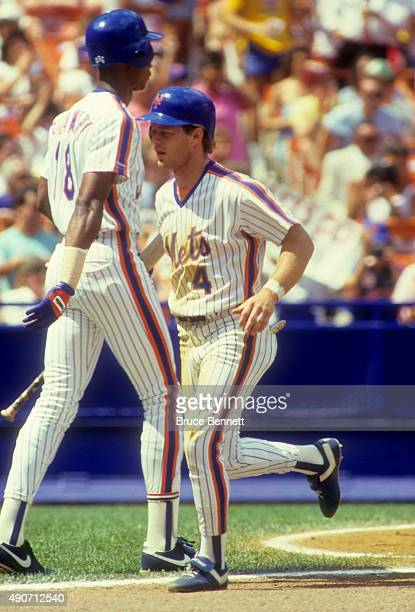 Lenny Dykstra of the New York Mets is congratulated by Darryl Strawberry during an MLB game against the San Francisco Giants in August 1987 at Shea...