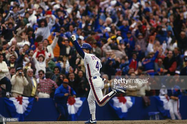Lenny Dykstra of the New York Mets pumps his fist in the air after a dramatic home run against the Houston Astros during Game 3 of the 1986 National...