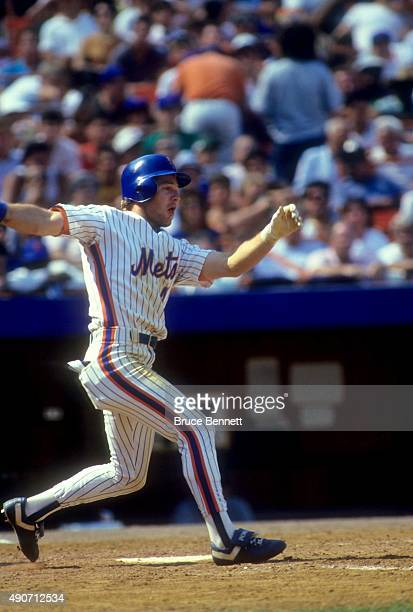 Lenny Dykstra of the New York Mets swings at a pitch during an MLB game against the San Francisco Giants in August 1987 at Shea Stadium in Flushing...