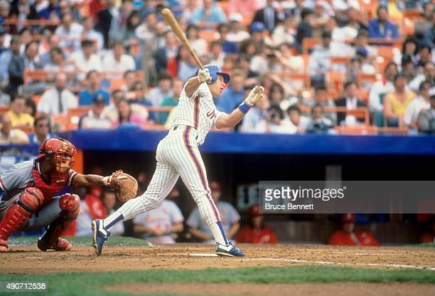 Lenny Dykstra of the New York Mets swings at a pitch during an MLB game against the St Louis Cardinals in April 1989 at Shea Stadium in Flushing New...