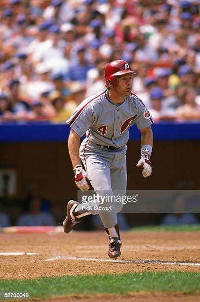 Lenny Dykstra of the Philadelphia Phillies runs to first base during a 1989 season MLB game against the New York Mets at Shea Stadium in Flushing New...