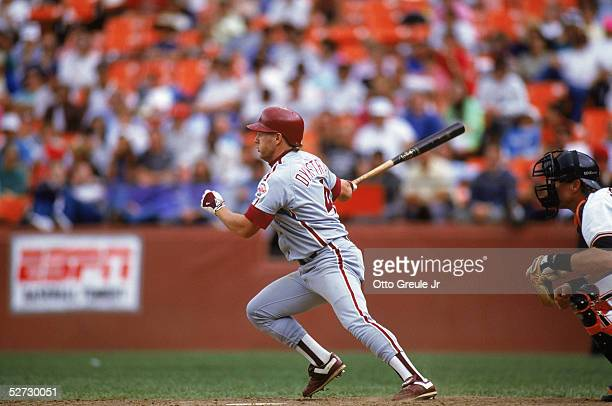 Lenny Dykstra of the Philadelphia Phillies swings at a pitch during a 1990 season MLB game against the San Francisco Giants at Candlestick Park in...