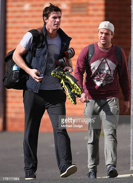Lenny Hayes and Adam Schneider leave a St Kilda Saints AFL training session at Moorabbin Oval on August 1 2013 in Melbourne Australia