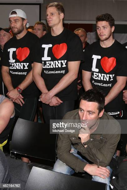 Lenny Hayes announces his retirement as former teamate Stephen Milne listens in front of Sam Fisher Nick Riewoldt and Jack Steven wearing shirts in...