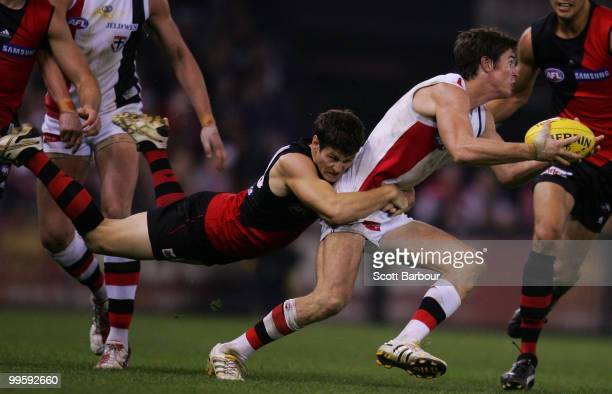 Lenny Hayes of the Saints is tackled by Ben Howlett of the Bombers during the round eight AFL match between the St Kilda Saints and the Essendon...