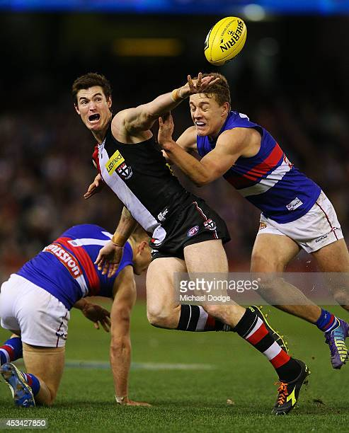Lenny Hayes of the Saints is tackled by Sam Darley of the Bulldogs during the round 20 AFL match between the St Kilda Saints and the Western Bulldogs...