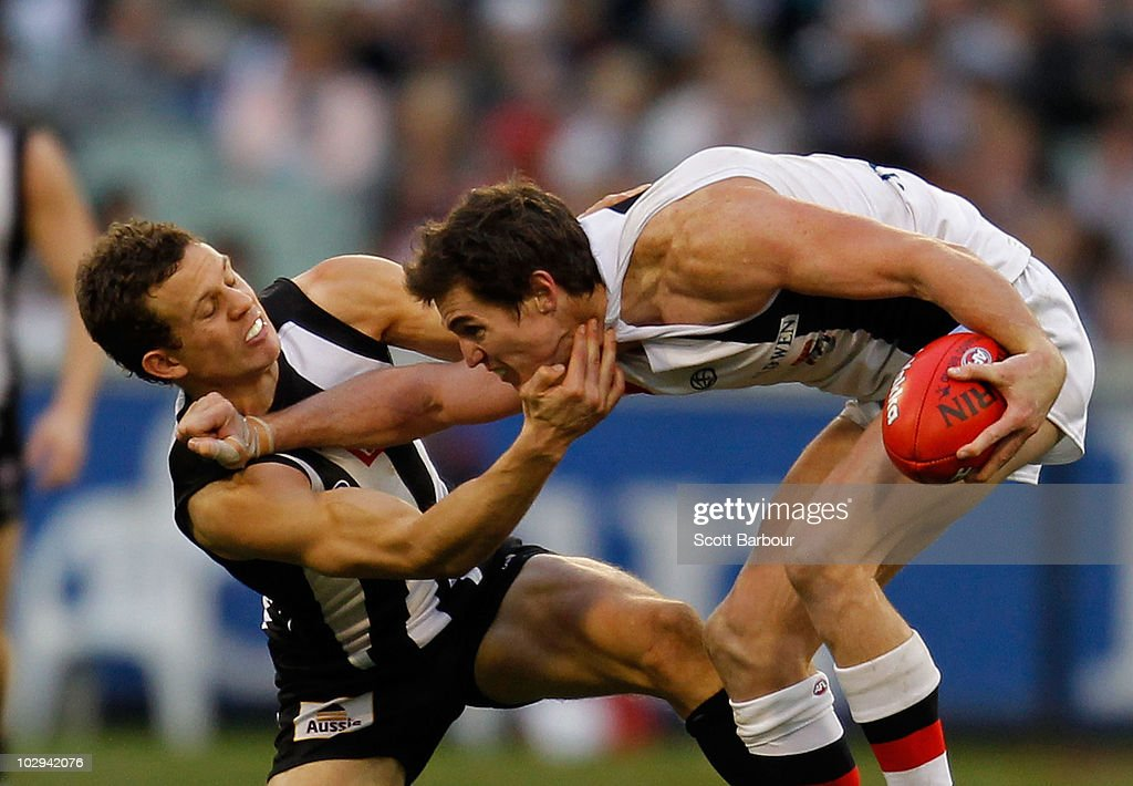 Lenny Hayes of the Saints is tackled during the round 16 AFL match between the Collingwood Magpies and the St Kilda Saints at Melbourne Cricket Ground on July 17, 2010 in Melbourne, Australia.