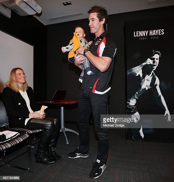 Lenny Hayes picks up 12 month old sonHunter Hayes from wife Tara Hayes after he announced his retirement during a St Kilda Saints AFL press...