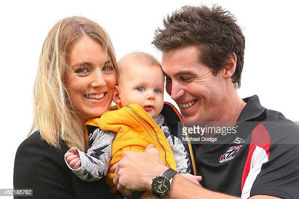 Lenny Hayes poses with 12 month old son Hunter Hayes and wife Tara Hayes after he announced his retirement during a St Kilda Saints AFL press...