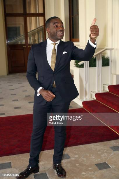 Lenny Henry attends the Queen's Young Leaders Award Ceremony as Queen Elizabeth II accompanied by Prince Harry Duke of Sussex and Meghan Duchess of...