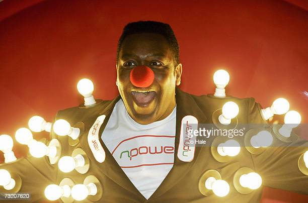 Lenny Henry supports Red Nose Comic Relief by wearing a light bulb jacket at Holborn Studios February 5 2007 in London England