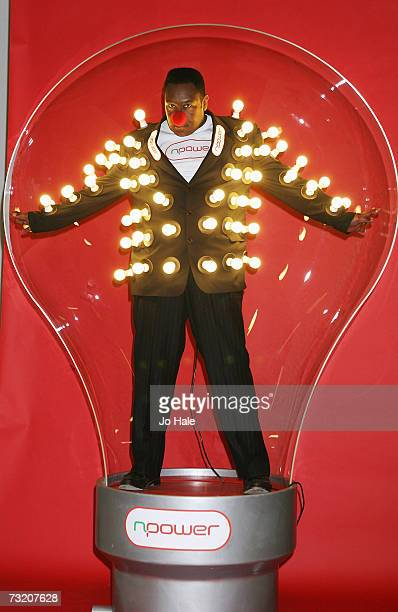 Lenny Henry supports Red Nose Comic Relief wearing a light bulb jacket at Holborn Studios February 5 2007 in London England