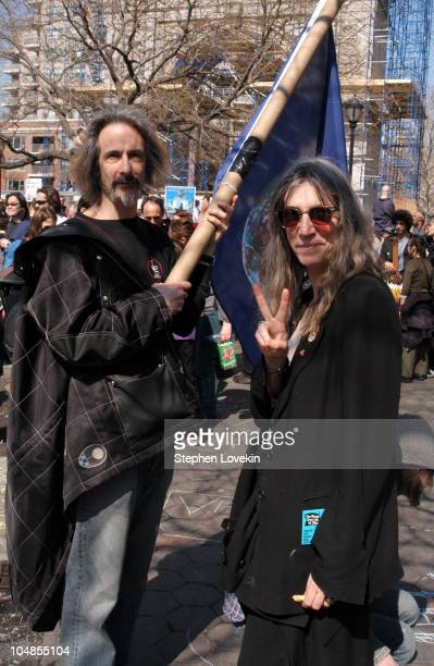 Lenny Kaye and Patti Smith during AntiWar Protesters March in New York City 2003 at Times Square to Washington Square Park in New York NY United...