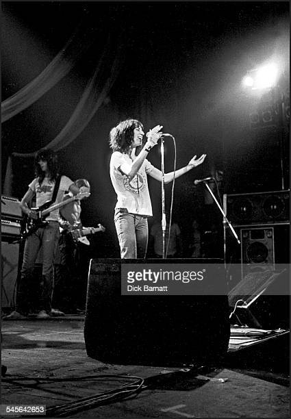 Lenny Kaye and Patti Smith of The Patti Smith Group perform on stage at Hammersmith Odeon London United Kingdom 23rd October 1976