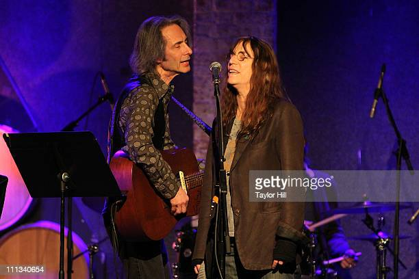 Lenny Kaye and Patti Smith perform during the Bridge To Japan Earthquake Tsunami Relief Benefit at City Winery on March 31 2011 in New York City