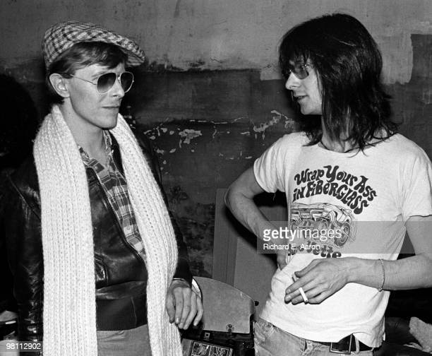Lenny Kaye from the Patti Smith Group posed with David Bowie at CBGB's club in New York City on April 04 1975