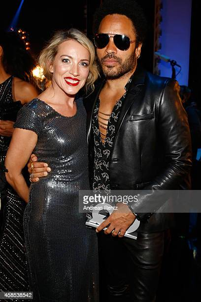 Lenny Kravitz and Sanny van Heteren are seen on stage at the GQ Men Of The Year Award 2014 at Komische Oper on November 6 2014 in Berlin Germany