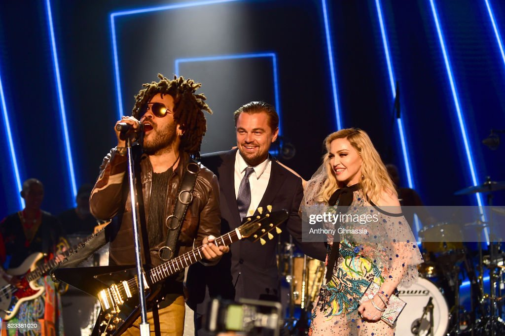 Lenny Kravitz, Leonardo DiCaprio and Madonna are seen on stage during the Leonardo DiCaprio Foundation 4th Annual Saint-Tropez Gala at Domaine Bertaud Belieu on July 26, 2017 in Saint-Tropez, France.