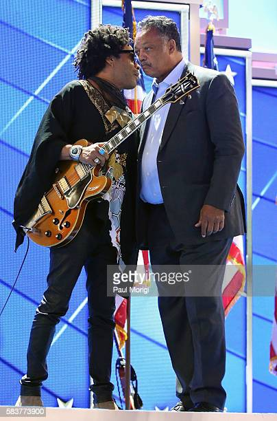 Lenny Kravitz talks with Reverend Jesse Jackson, Sr. On the third day of the Democratic National Convention at the Wells Fargo Center on July 27,...