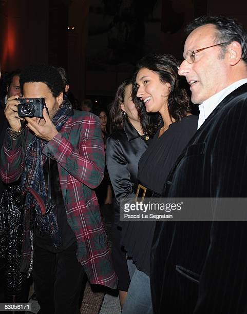 Lenny Kravitz Zofia Reno and Actor Jean Reno attend the Patrick Demarchelier's exhibition Party on September 29 2008 in Paris France