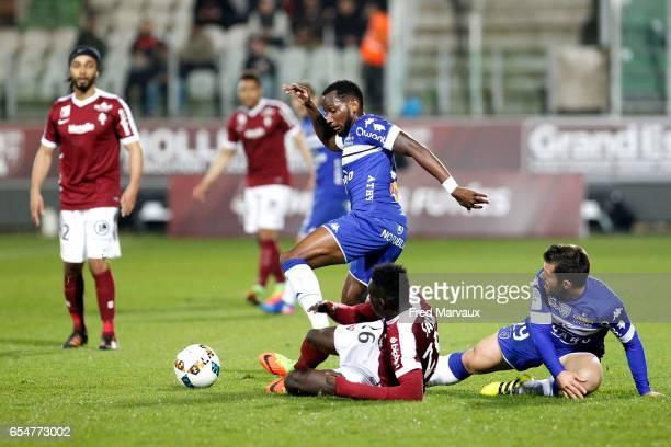 Lenny Nangis of Bastia and Ismaela Sarr of Metz and Gilles Cioni of Bastia during the Ligue 1 match between Fc Metz and SC Bastia at Stade...