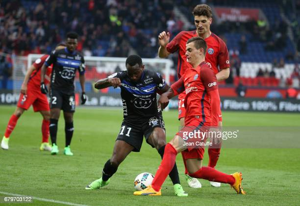 Lenny Nangis of Bastia Giovani Lo Celso Thomas Meunier of PSG in action during the French Ligue 1 match between Paris SaintGermain and SC Bastia at...