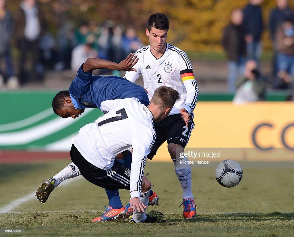 Lenny Nangis of France (l) challenges against Yannick Gerhardt (front) and Robin Yalcin during the International Friendly match between U19 Germany and U19 France at Rheinstadium on November 14, 2012 in Kehl, Germany.