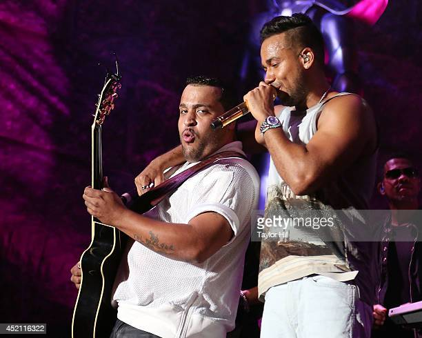 Lenny Santos and Romeo Santos of Aventura perform in concert at Yankee Stadium on July 12 2014 in New York City