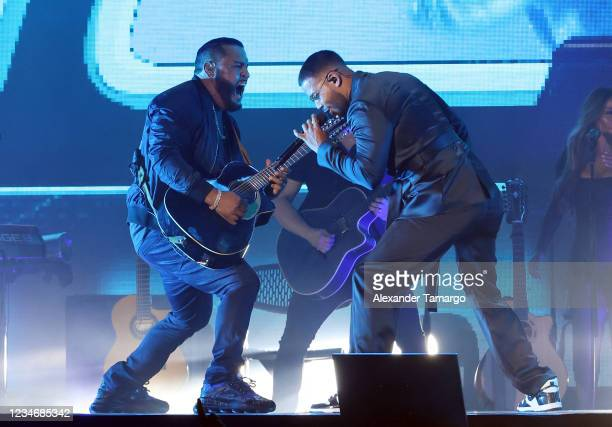 Lenny Santos and Romeo Santos of the group Aventura perform on stage during the Inmortal Tour at Hard Rock Stadium on August 14, 2021 in Miami...