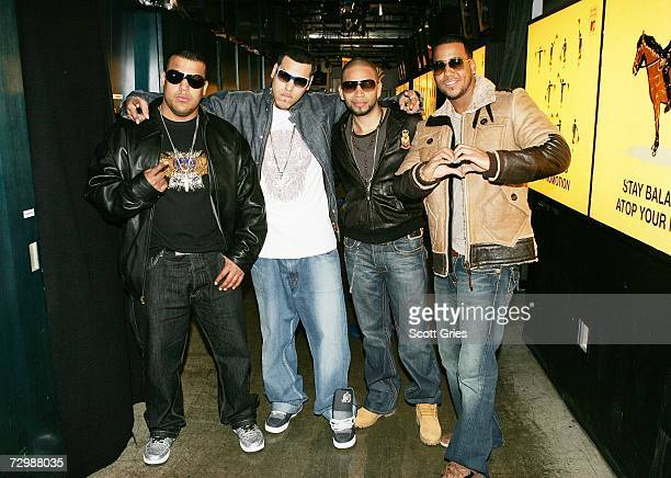 Lenny Santos Max Santos Henry Santos and Anthony Santos of the band Aventura pose for a photo backstage during MTV's mi Total Request Live at the MTV...