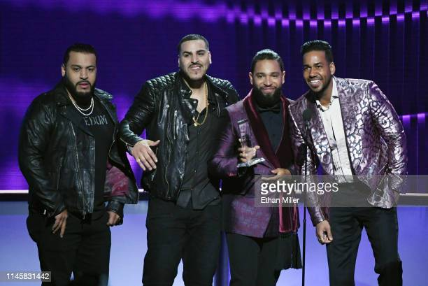 Lenny Santos Max Santos Henry Santos and Romeo Santos of Aventura accept the Tropical Artist of the Year Duo or Group award during the 2019 Billboard...