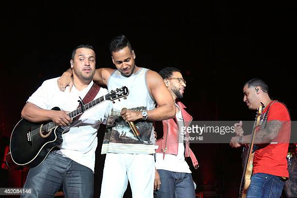 Lenny Santos Romeo Santos Henry Santos and Max Santos of Aventura reunite for their first performace in over three years in concert at Yankee Stadium...