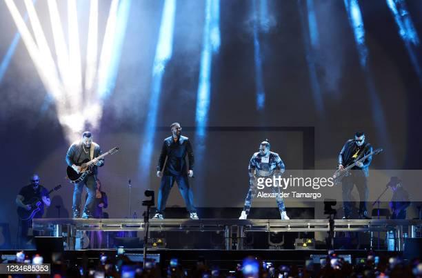 Lenny Santos, Romeo Santos, Henry Santos and Max Santos of the group Aventura perform on stage during the Inmortal Tour at Hard Rock Stadium on...