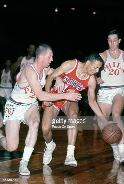 Lenny Wilkens of the St Louis Hawks dribbles the ball against the Philadelphia 76ers during an NBA basketball game circa 1965 at Convention Hall in...