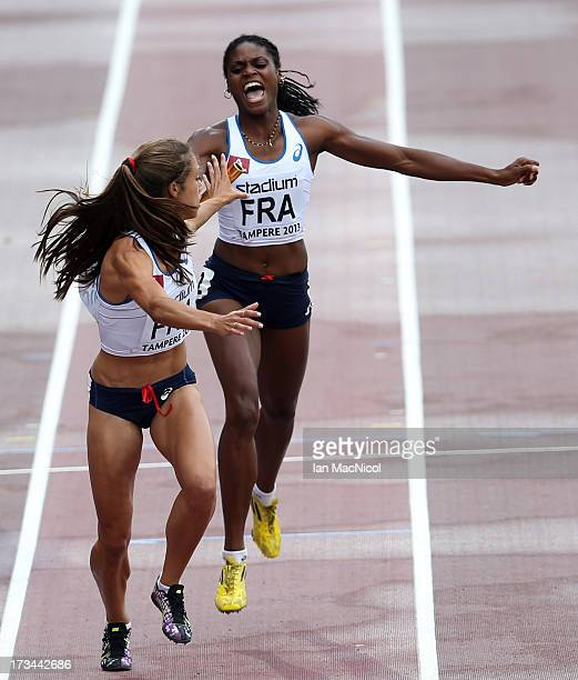 Lenore Guion Firmin of France passes the baton to Justine Fedronic during the Women's 4x400m Final sees LouiseAnne Bertheau lead off during day four...