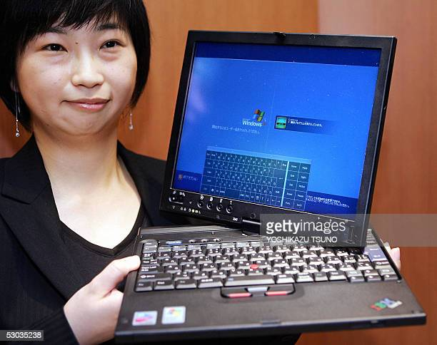 Lenovo Japan employee Kaori Kimura displays the new tablet PC 'ThinkPad X41 Tablet' equipped with an Intel's Pentium M 758 procesor on its CPU and...