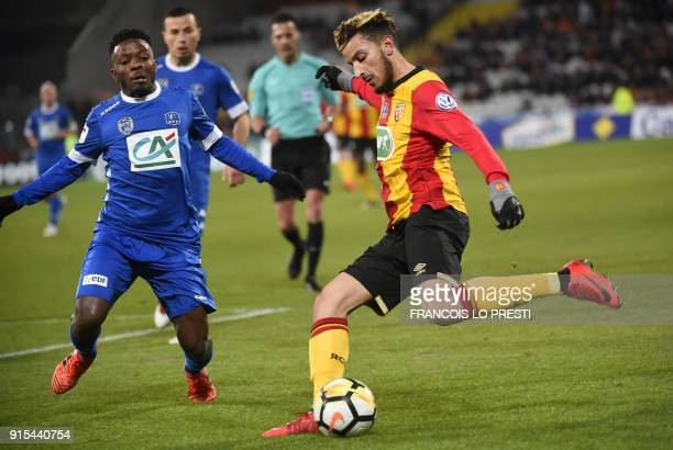 Lens' Abdellah Zoubir vies with Troyes Jeremy Cordoval during the French Cup round of 16 football match between Lens and Troyes on February 7 the at...