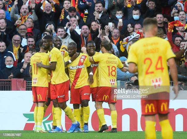 Lens' Cameroonian forward Ignatius Ganago celebrates with teammates after scoring a goal during the French L1 football match between RC Lens and FC...