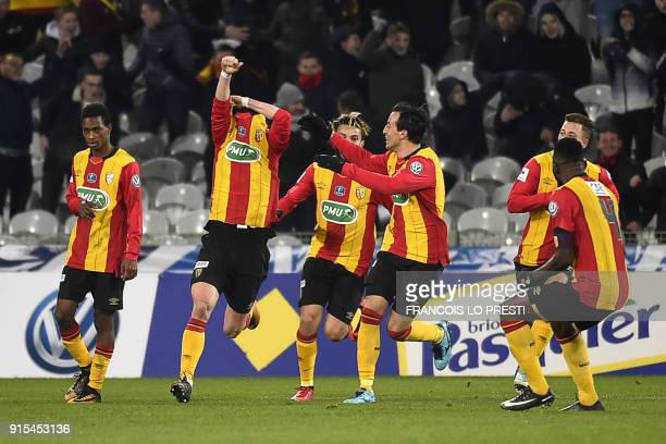 Lens' Christian Lopez takes his jersey off as he celebrates scoring a goal during the French Cup round of 16 football match between Lens and Troyes...
