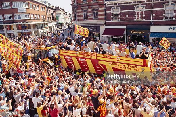 Len's fans during the parade celebrate RC Lens' victory, winning both the Championship title and French Cup.