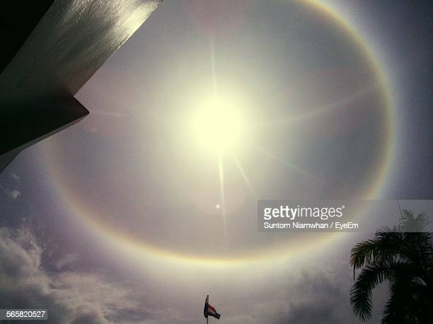 Lens Flare In Cloudy Sky